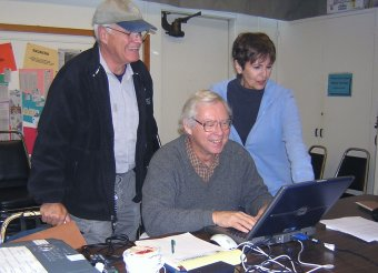 Photograph of 3 Omnilore Members at a computer